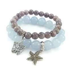 Szaro niebieskie bransoletki z kamieni jadeitu i marmuru z zawieszkami charms motylem i gwiazdą.