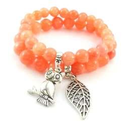 Bransoletki z pomarańczowym marmurem z charmsami sową i liściem.
