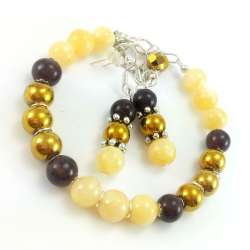 Zestaw biżuterii bransoletka i kolczyki ze złotego hematytu i  marmurów w żółci i brązie.