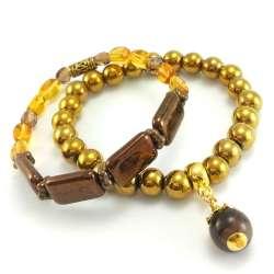 Złote bransoletki z hematytem i koralikami szklanymi.