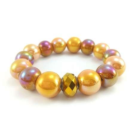 Złota bransoletka z kulami ceramiki i koralikiem modułowym- kryształkiem.