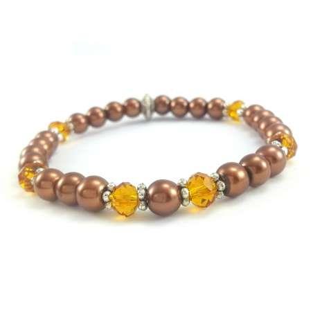 Bransoletka ze szklanych, brązowych pereł i miodowych kryształków.