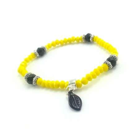 Bransoletka z żółtych i czarnych kryształów szklanych z małym listkiem.